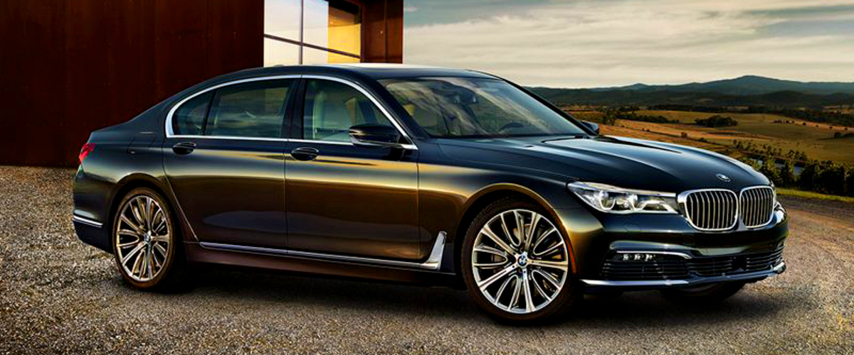 A Luxury Car, Bmw 7 On The Road, Ina Deep Brown Shiny Color
