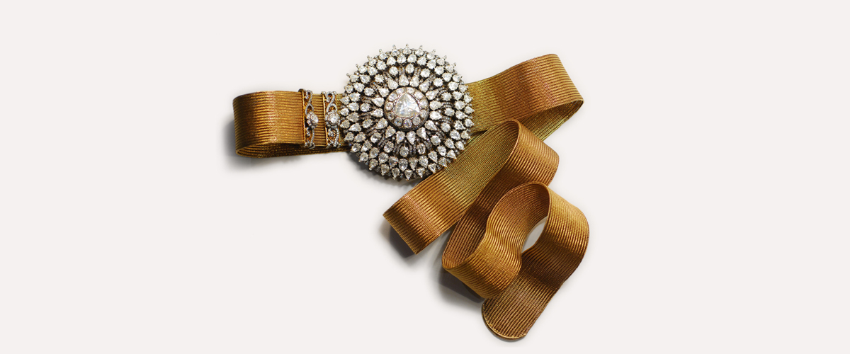 A Waistband With Detsiled Round Flower In The Centre Embellished With Shiny White Gems