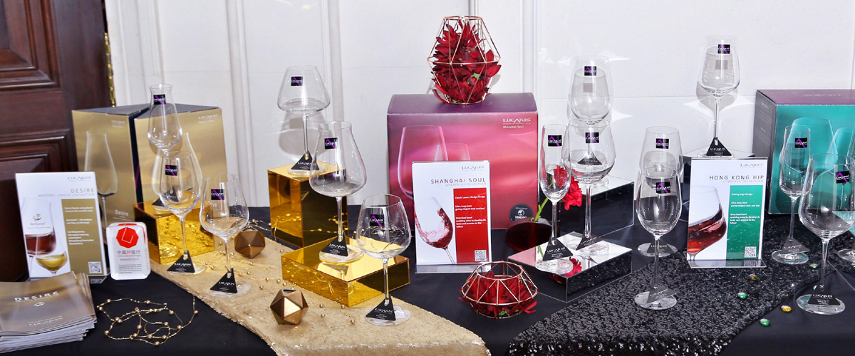 A Grand Collection Of Wines Glasses Of Different Types In Various Boxes And Bottles, Wrapped Like A Luxury