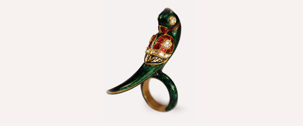A Dark Green And Red Parrot Detailed Ring With White Gems In It To Addto The Beauty