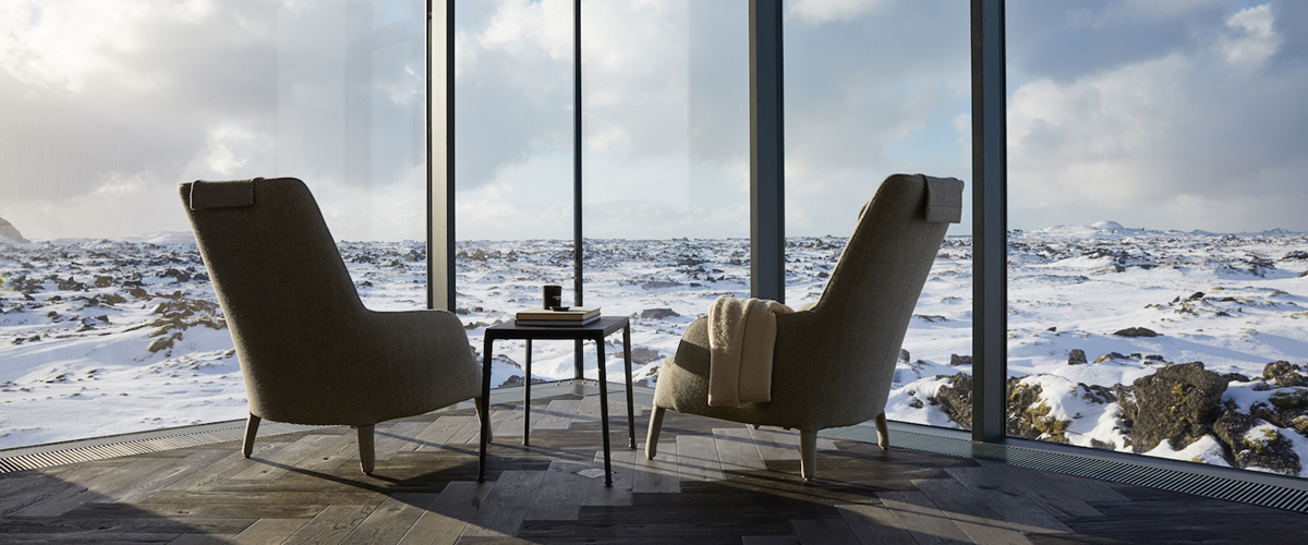 Iceland, the retreat resort, outside view of snow, from toughened glass wall, couple of resting chair and modular flooring