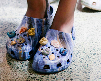 Luxury footwear showcased by crocs embellished with designer stones as a fashion aid, pairing comfort with street style.