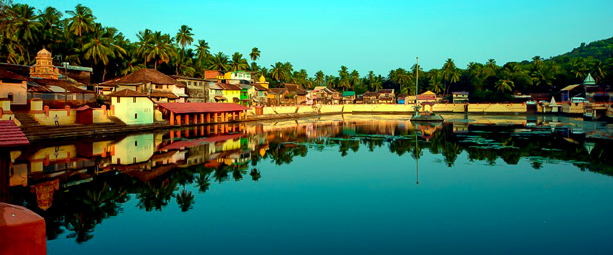 Gokarna, Karnataka, western coast of India, mountains, huts, palm tree reflection in beach, beach with temples