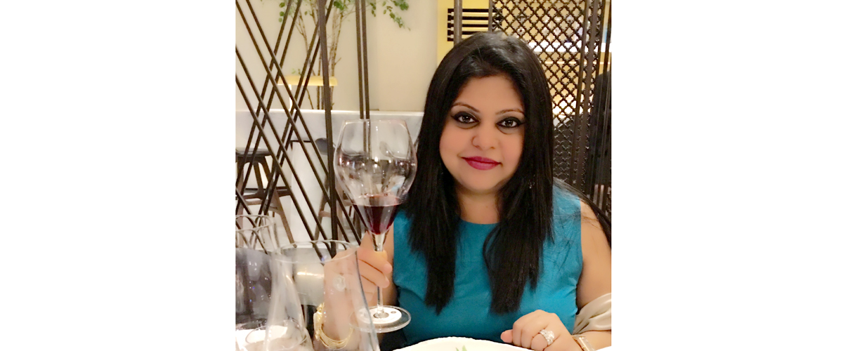 sonal holland, the wife of best red wine maker with a glass of red wine in her hand