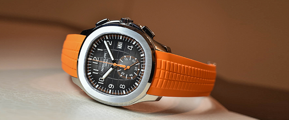 A Patek Phillipe In A Subtle Orange And Black Dial Highlighted By White Needles And Numbers