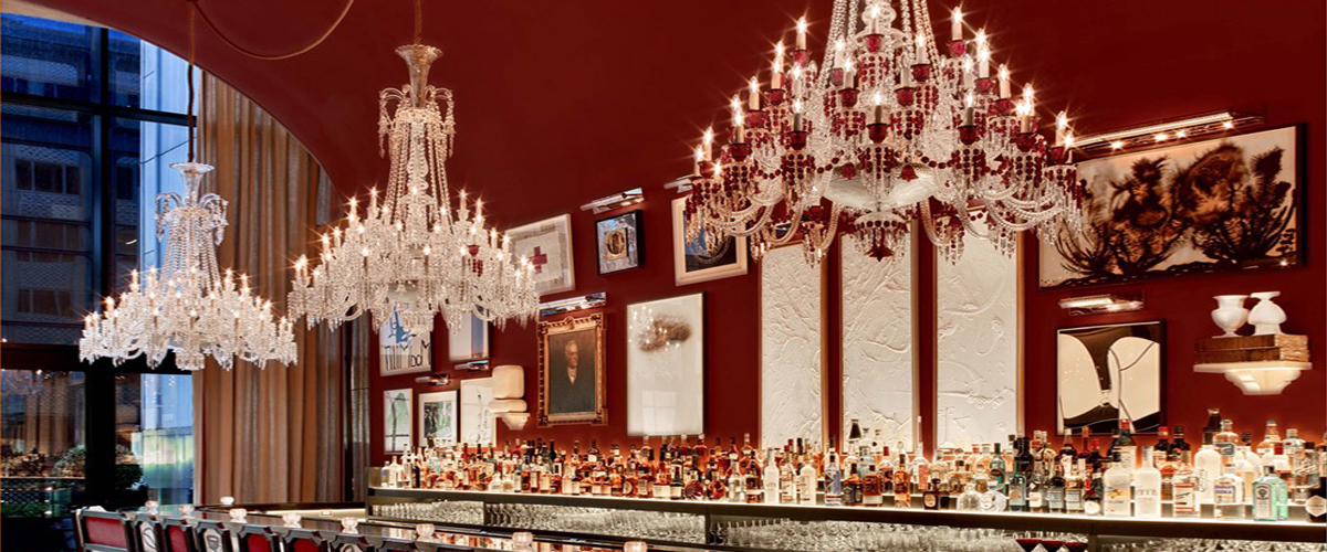 Baccarat New York, luxury hotel, 64 point chandelier crystal lamps handcrafted art, legacy of the Baccarat Crystal Company