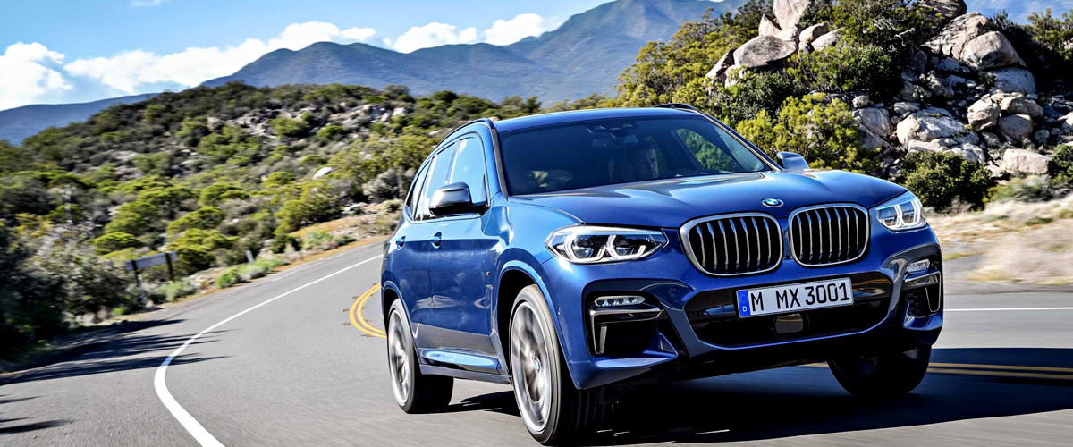 A Bmw X3, Newly Launched, In Blue Color Shining Out On The Road