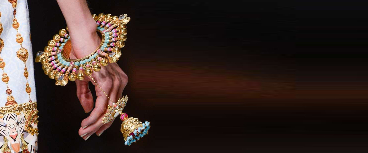 A statement candy-hued gold bangle by Manish Arora, an Indian designer known for his quirky designs