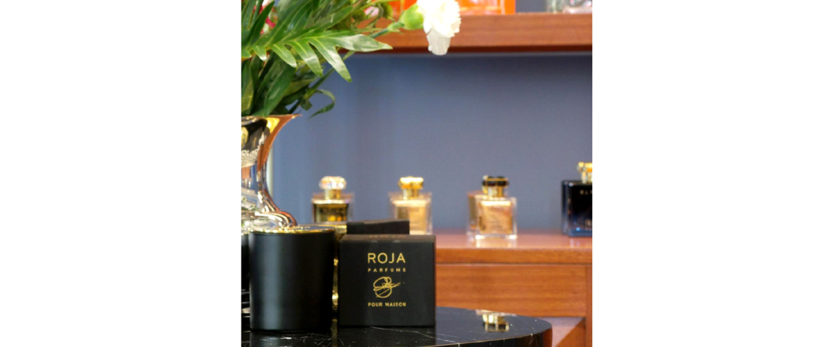 Bottled up scents by roja luxury brand in jet black attractive bottles, carved upon with golden the logo and name of luxury.