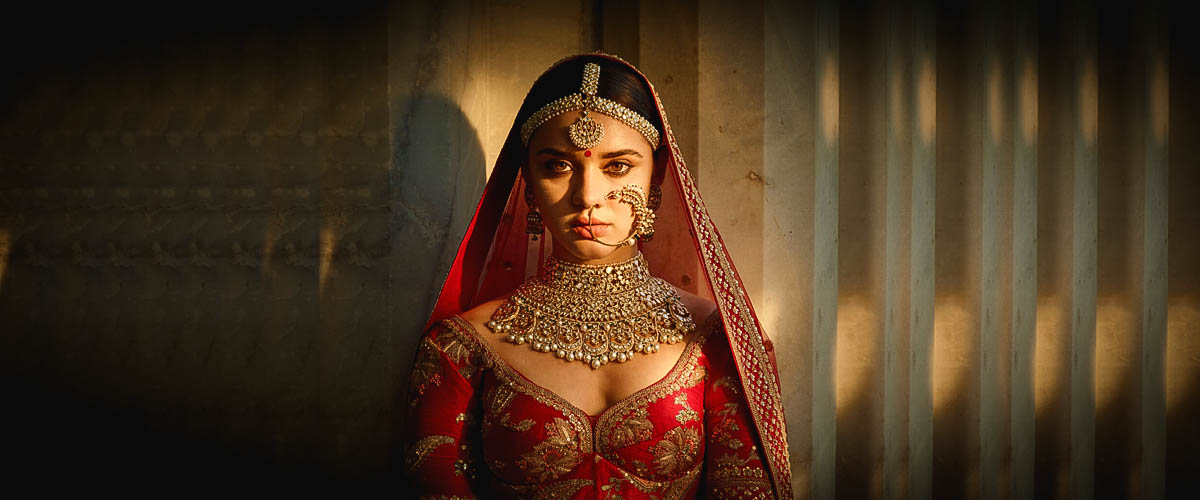 A stunning diamond and ruby necklace from Sabyasachi's designer jewellery collection worn by Deepika Paukone