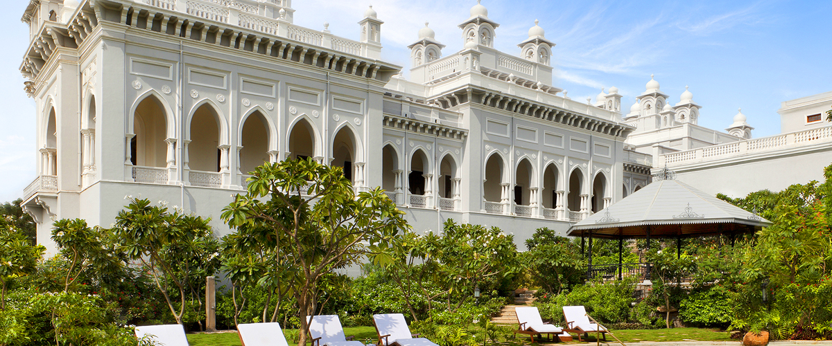 The gorgeous pristine white exteriors of the Taj Falaknuma Palace in Hyderabad, one of the best heritage properties in India