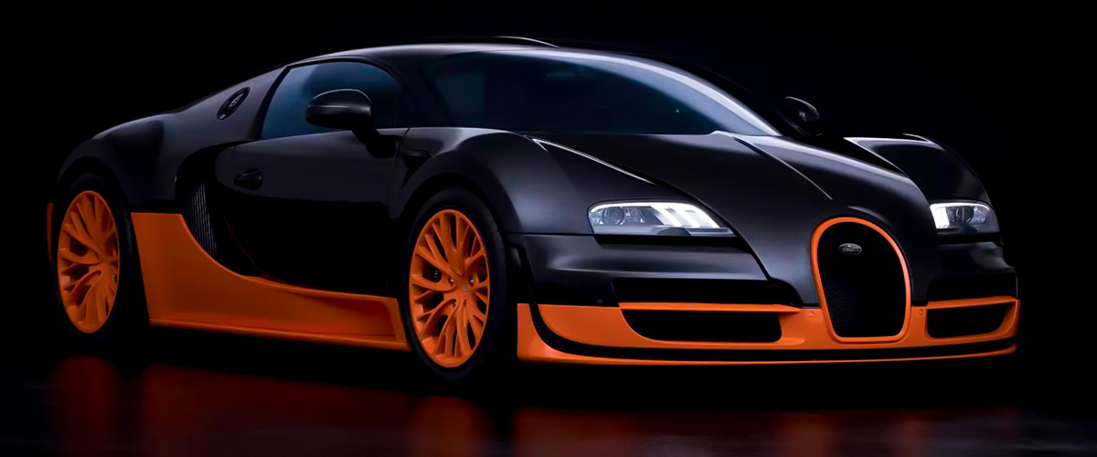 A matte-finish Bugatti Veyron in black and orange hues that make the car resemble Batman's super sexy mobile