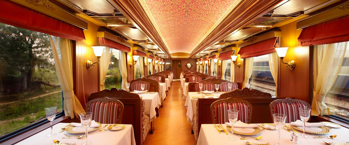 A fine dining space within the Maharaja Express where each table is laden with delicious, gourmet food and the view is equally spectacular.