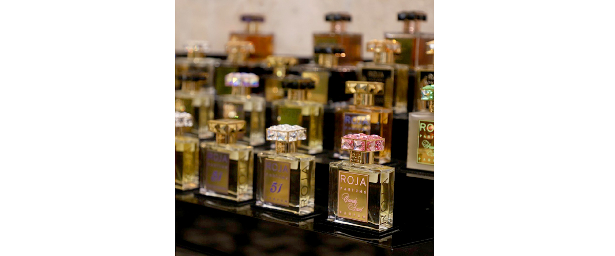 A wide range of blissful scents by roja in designer golden bottles embellished with acvaried series of colorful tops.