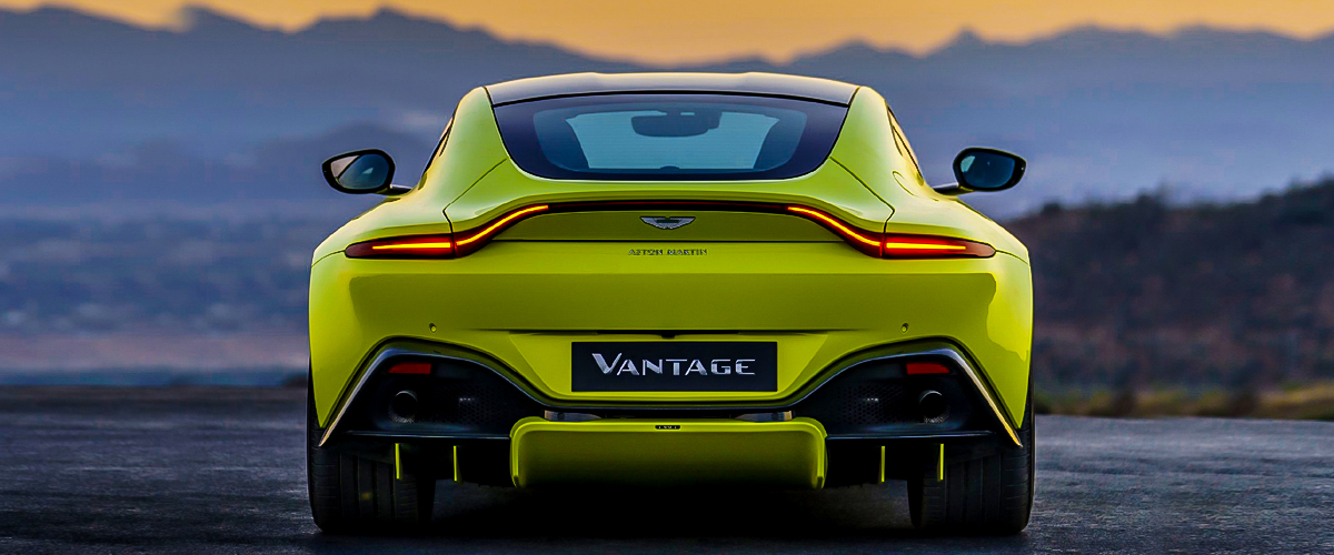 The rear of the car vantage by aston martin. The lights are designed and unique.