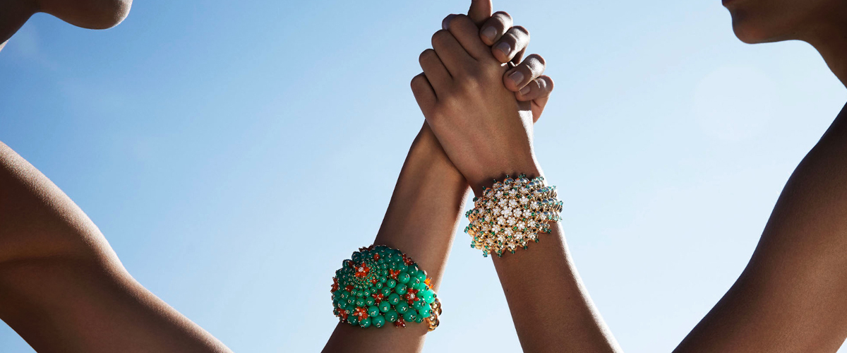 These statement cuffs from Cartier's Cactus de Cartier collection feature diamonds and emeralds